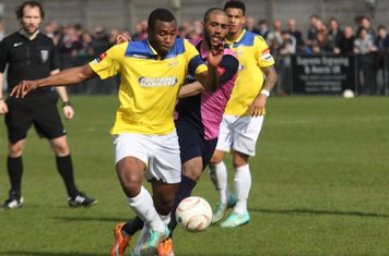 Enfield's Stanley Muguo (yellow) and Dulwich's Ashley Carew