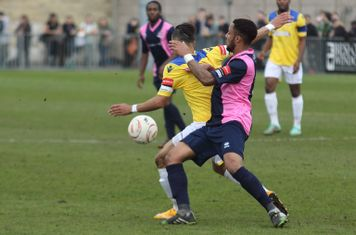 Dulwich's Frazer Shaw (R) and Enfield's Corey Whitely