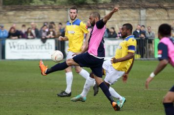 Dulwich's Ashley Carew (L) clears from Stanley Muguo