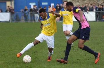 Enfield's Michael Kalu (L) and Dulwich's Ethan Pinnock