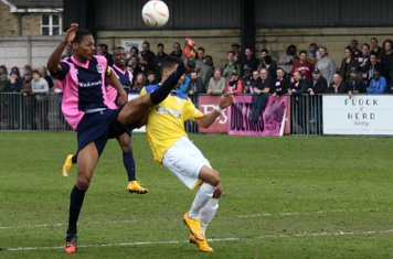 Dulwich's Ethan Pinnock (L) clears from Corey Whitely
