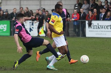 Dulwich's Jack Dixon (L) tackles Stanley Muguo