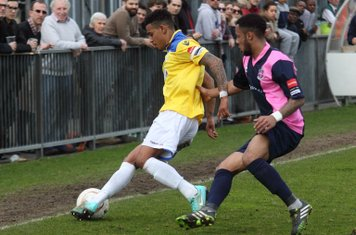 Enfield's Nathan Livings (L) and Dulwich's Frazer Shaw