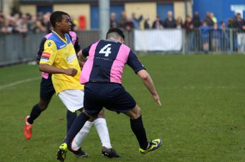 Enfield's Dernell Wynter (L) and Dulwich's Jack Dixon