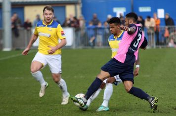 Dulwich's Frazer Shaw (3) tackles Nathan Livings