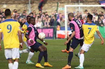 Dulwich's Jordan Hibbert (pink/blue, L) and Ashley Carew combine to close down Nathan Livings (R) and Corey Whitely