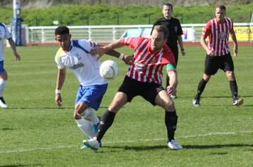 Enfield's Nathan Livings (L) and Hornchurch captain Elliott Styles