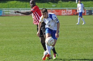 Tobi Johnson (L) of Hornchurch and Enfield's Ryan Doyle