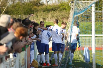 Enfield players and fans celebrate the second goal