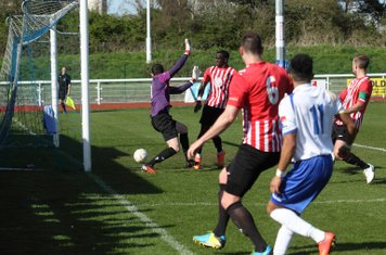 Corey Whitely (hidden by the two players in the foreground) scores the third Enfield goa
