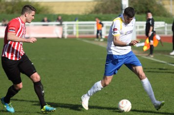 Enfield's Claudiu Vilcu (R) and Hornchurch's Frank Curley