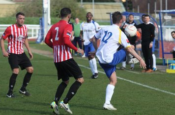 Enfield's Liam Hope (R) and Hornchurch's Danny Woodards (2) and Danny Johnson
