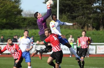 Hornchurch keeper Sam Mott catches under pressure from Phil Kane
