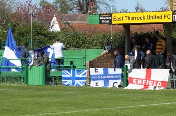 The Enfield fans arrange their flags before the game