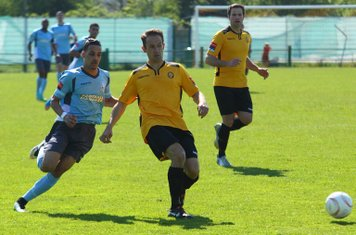 Enfield's Corey Whitely (L) and East Thurrock's Ben Wood