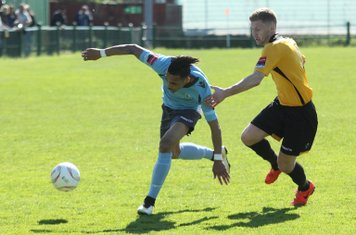 Enfield's Corey Whitely (L) and East Thurrock's Lewis Smith