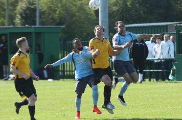 Enfield's Corey Whitely (R) and Bobby Devyne challenge Paul Goodacre