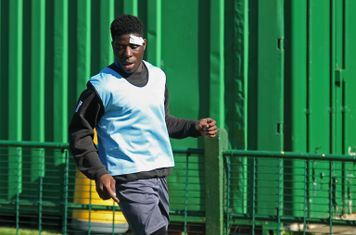 Enfield's Isaac Nkosi, not involved in the game after suffering a cut head in midweek, warms up at half time