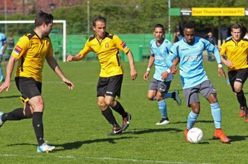 Enfield's Bobby Devyne (blue, R) and East Thurrock's Paul Goodacre (L) and Ben Wood