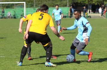 Enfield's Bobby Devyne (R) and East Thurrock's Paul Goodacre