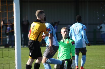East Thurrock's Tom Stephen (L) and keeper David Hughes start the inquest into the Enfield goal