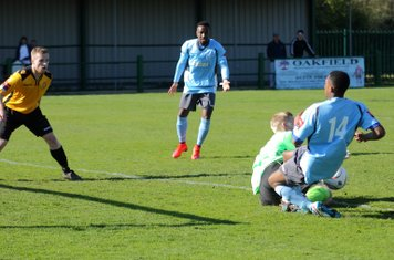East Thurrock keeper David Hughes saves at the feet of Dernell Wynter