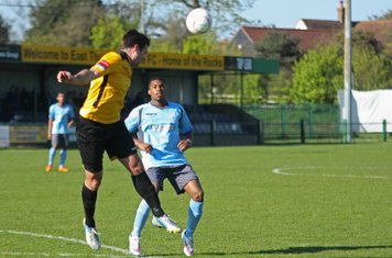 East Thurrock's Paul Goodacre heads clear from Dernell Wynter