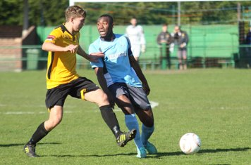 East Thurrock's Connor Witherspoon (L) and Enfield's Stanley Muguo