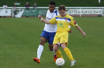 Witham's John Watson (R) clears from Michael Kalu