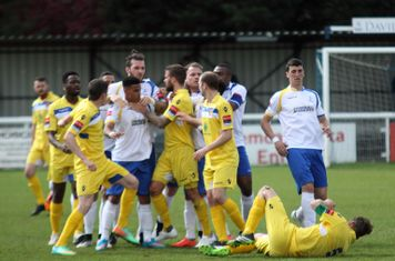 Tempers flare after a foul by Witham's Paul King (yellow, R). King flew backwards out of the melee; most of the anger seems to be aimed at Nathan livings but it was Joe Ellul (behind Livings) who was red carded. King received a yellow for the original fou