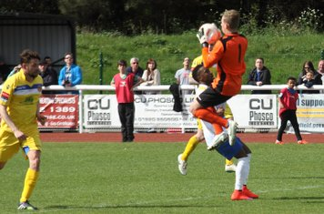 Witham keeper Louis Godwin-Green collects ahead of Bobby Devyne