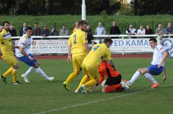 Enfield's Ryan Doyle (R) is knocked over in a collision with Lee Townrow (4) and keeper Louis Godwin-Green