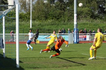 Louis Godwin-Green saves  from Enfield's Nathan Livings (L)