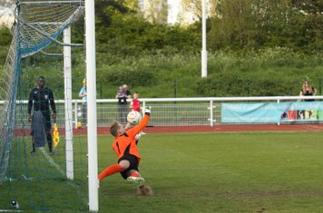 Witham's Louis Godwin-Green saves Ryan Doyle's penalty
