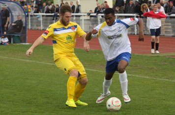 Witham's Conor Mead (L) and Enfield's Dernell Wynter
