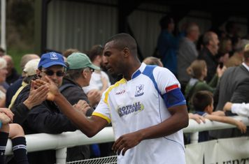 Enfield captain Stanley Muguo leads the team in thanking the supporters