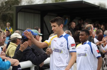 Enfield's Ryan Doyle (L) and Dernell Wynter thank the home support