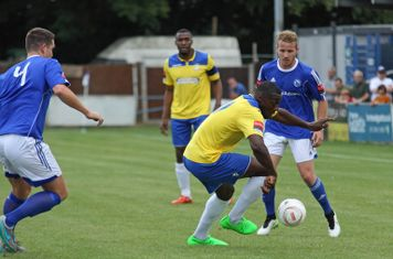 Enfield's Alex Cathline and Billericay's Frank Curley (L) and Conor Hubble
