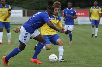 Enfield's Tayshan Hayden-Smith (R) and Billericay's Ola Williams