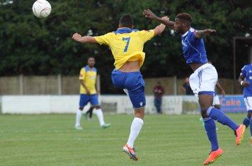 Billericay's Ola Williams (R) heads clear from Samir Bihmoutine