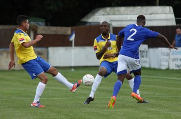 Enfield's Samir Bihmoutine (L) and Ricky Gabriel and Billericay's Ola Williams