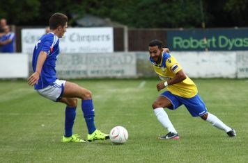 Billericay's Tom Derry (L) and Enfield's Tyler Campbell