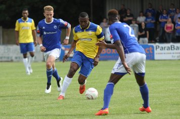 Enfield's Stanley Muguo and Billericay's Conor Hubble (L) and Ola Williams