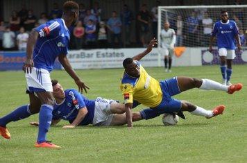 Enfield's Stanley Muguo (R) tackled by Joe Ellul