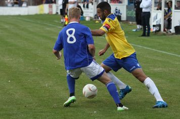 Billericay's Conor Hubble (L) and Enfield's Aryan Tajbakhsh