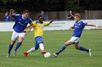 Enfield's Bobby Devyne challenged by Frank Curley (L) and Conor Hubble