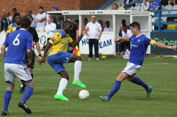Enfield's Alex Cathline (yellow) takes on Frank Curley