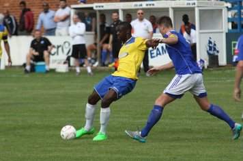 Enfield's Alex Cathline (yellow) holds off Frank Curley