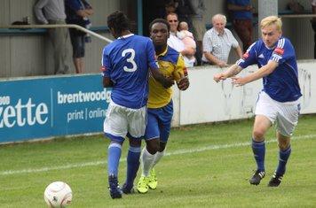 Enfield's Olumide Durejayi (yellow) is blocked by Alex Stephenson