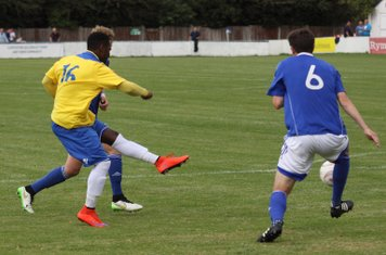 Bobby Devyne (yellow) records Enfield's first shot on target